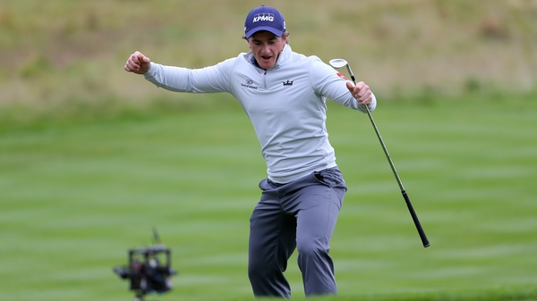 Paul Dunne celebrates chipping in at the 18th