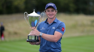Dunne won the British Masters by three shots