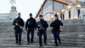 Police offciers stand guard at the train station in Marseille