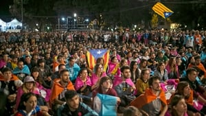 Hundreds of people celebrate  after the Catalonia independence referendum in Barcelona, Spain