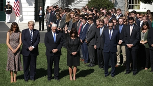 US President Donald Trump held a minute's silence at the White House alongside First Lady Melania Trump, Vice President Mike Pence and Second Lady Karen Pence