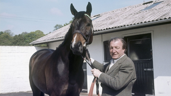 Charles Haughey holds a horse by the reins in the grounds of his home in Abbeville, Kinsealy, County Dublin, in a shot taken for RTÉ Television's 'People and Power' in May 1975.