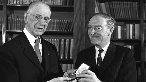 President Eamon de Valera presents Liam Cosgrave with his seal of office in 1973