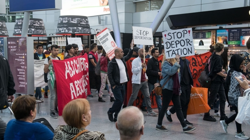 Activists protest against the expulsion of Afghan refugees at Dusseldorf airport in Germany