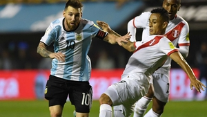 Argentina's Lionel Messi is marked by Peru's Victor Yotun