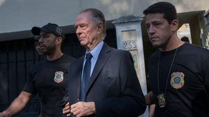 Brazil's Olympic Committee chief Carlos Nuzman (centre) is escorted from his home by federal police in Rio de Janeiro