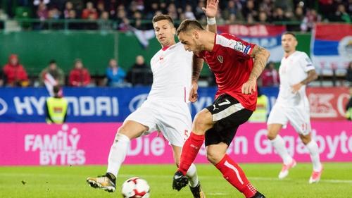 Austria's Marko Arnautovic (R) kicks the ball in front of Serbia's Matija Nastasic