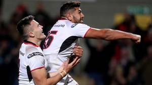 Ulster's Jacob Stockdale celebrates his try with Charles Piutau
