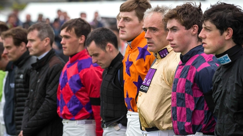 Ruby Walsh stands with fellow jockeys for a minutes silence in memory of JT McNamara at the 2015 Galway Festival