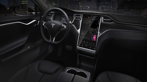 Tesla's huge infotainment screen is a class-leader. But how many functions should be available when driving ?