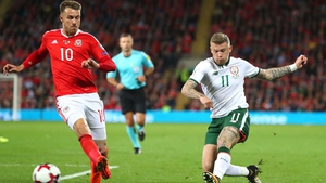 James McClean gets a shot off despite the attentions of Aaron Ramsey