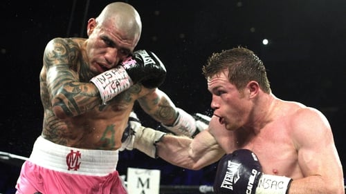 Miguel Cotto (l) exchanges blows with Saul 'Canelo' Alvarez during their middleweight championship fight in 2015