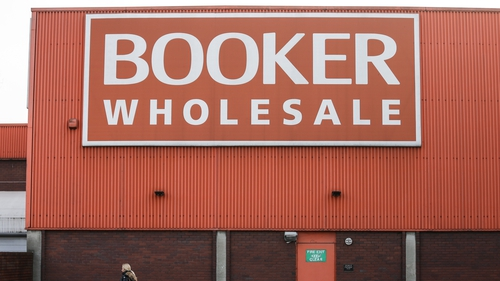 Charles Wilson, the executive director who leads Tesco's Booker wholesale business, will retire next year