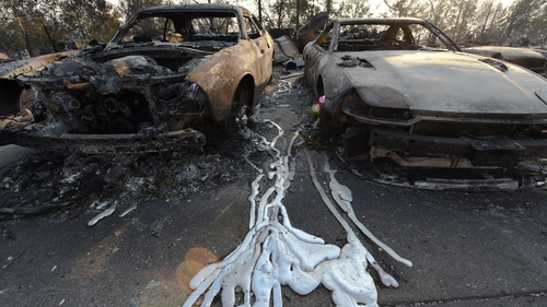 Melted metal from burnt cars seen on the ground after wildfires ripped through Santa Rosa