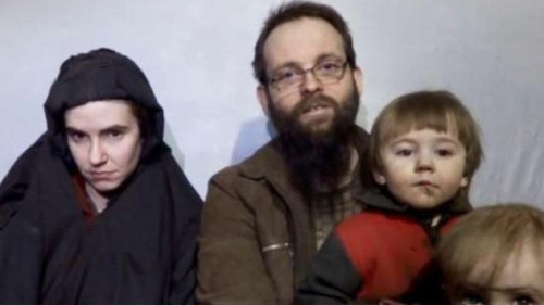 Caitlan Coleman and Joshua Boyle pictured with two of the children