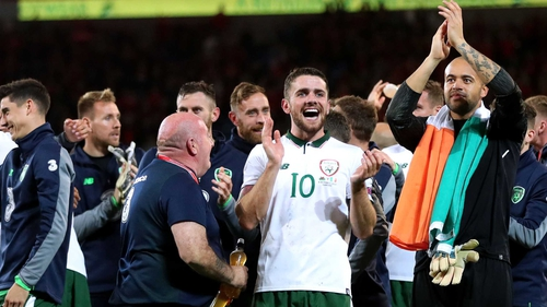 Robbie Brady salutes the fans after a famous win in Wales