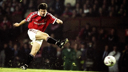 Denis Irwin in action against Liverpool at Old Trafford in 1998
