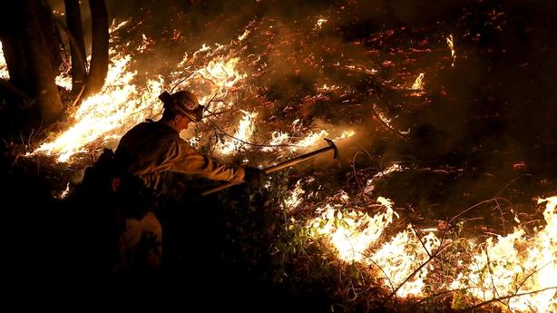 A fireman battles wildfire in California