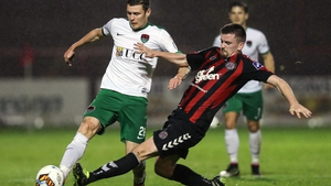Cork's Garry Buckley is tackled by Dan Byrne of Bohemians