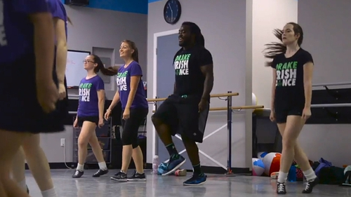Alex Collins with his classmates at the Drake School of Irish Dance Screengrab: The MMQB/Sports Illustrated