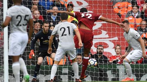 David De Gea made a vital first-half save to keep a clean sheet at Liverpool