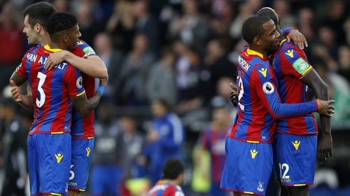 Crystal Palace players celebrate their forts win of the season