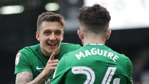 Seán Maguire and Jordan Hugill celebrate a goal for Preston North End.