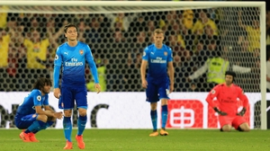 Arsenal players dejected after conceding a late winner at Watford