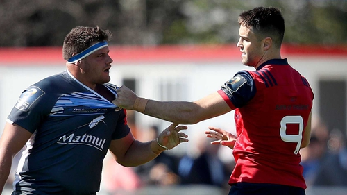 Conor Murray gets to grips with an opponent