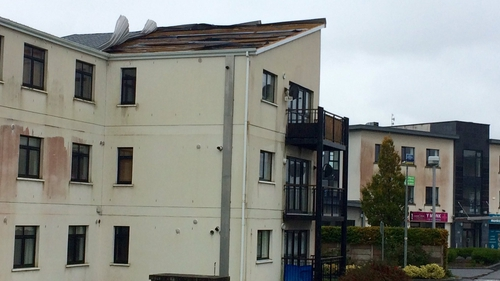 The roof is being peeled off an apartment building at River Village, Athlone