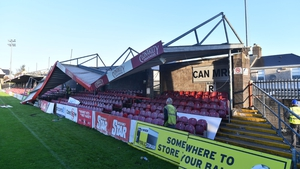 Workmen survey the damage to the roof of Turners Cross stadium in Cork