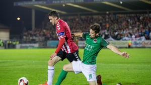 Cork City's Gearoid Morrissey with Dean Jarvis of Derry City