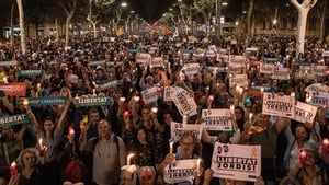 Around 200,000 people have taken to the streets of Barcelona for a candle-lit protest