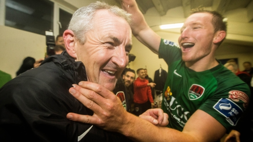 Caulfield celebrates in the dressing room after the game