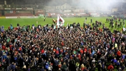Cork City fans invade the pitch to celebrate their title success