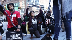 Protesters outside the NFL meeting in New York