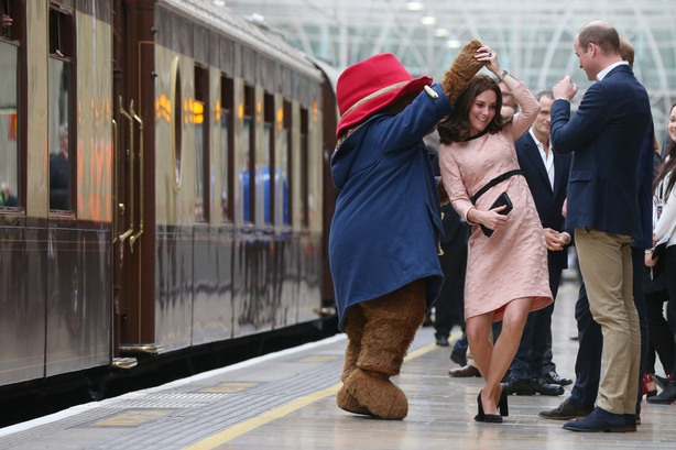 Catherine, Duchess of Cambridge dances with Paddington bear on platform 1 at Paddington Station