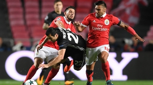 Eduardo Salvio of Benfica and United's Henrikh Mkhitaryan clash