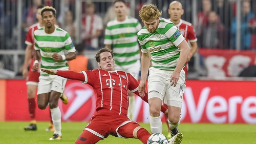 Stuart Armstrong (R) is challenged by Bayern Munich's Sebastian Rudy
