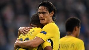 PSG's Edinson Cavani embraces Kylian Mbappe