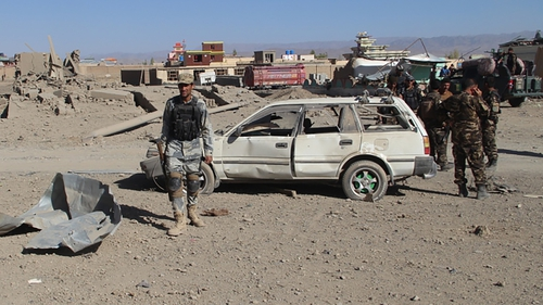 Afghan security personnel at the site of an attack at a police training centre in Gardez earlier this week