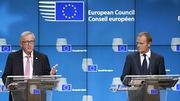European Council president Donald Tusk (R) and EU Commission President Jean-Claude Juncker