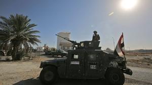 Iraqi forces guard an oil field west of Kirkuk