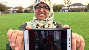 Fatima Halawa holding a picture of her brother
