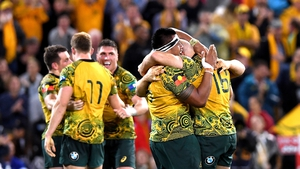 Australian players celebrating after the final whistle.