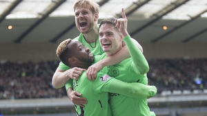 Moussa Dembele (L) celebrates his goal, Celtic's third, with Michael Lustig and Stuart Armstrong