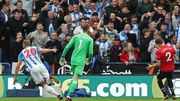 Huddersfield Town's Belgian striker Laurent Depoitre (L) wheels away in celebration after making it 2-0 against Manchester United