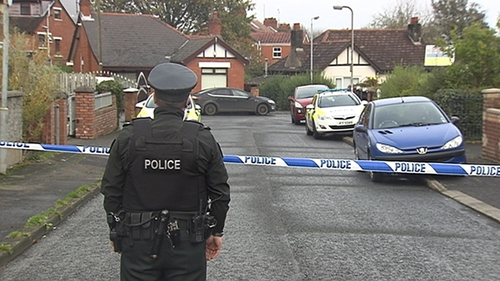 The woman was discovered injured in the back garden of a home, police said