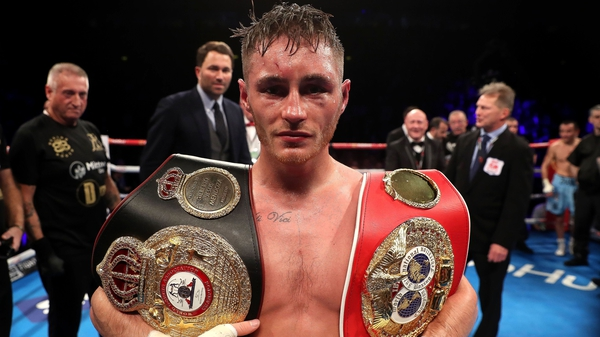 Ryan Burnett with his two belts