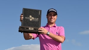Justin Thomas holds the trophy after winning the CJ Cup